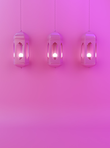 1142531551 istock photo Arabic lantern on pink gradient pastel background copy space text. 1129245308