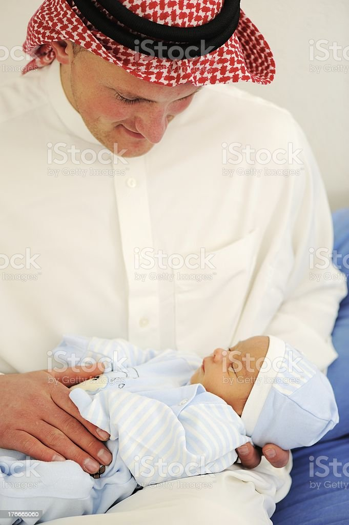 Arabic man holding a newborn baby royalty-free stock photo