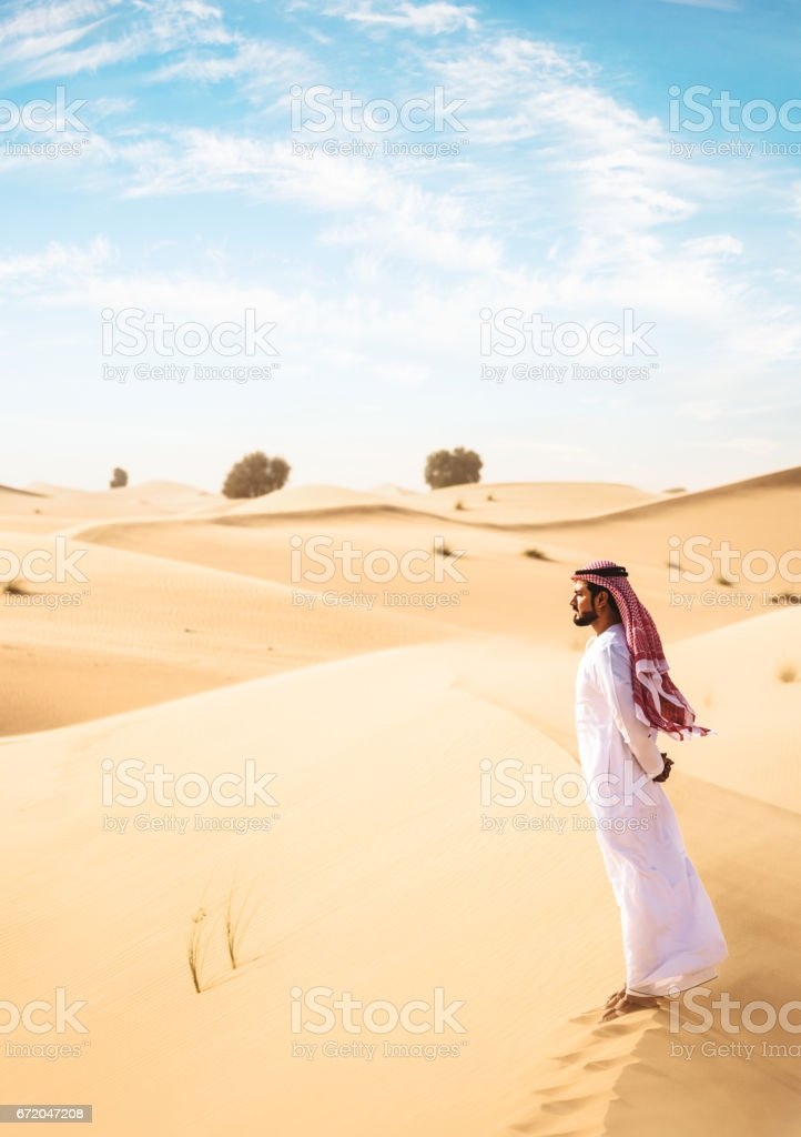 arabic man observing the heritage stock photo