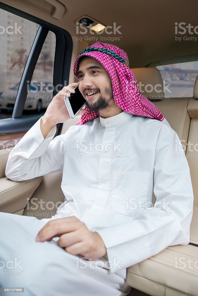 Arabic man talking on the phone in car stock photo