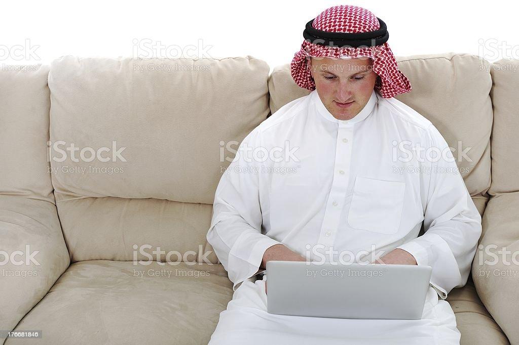Arabic man using laptop at home royalty-free stock photo