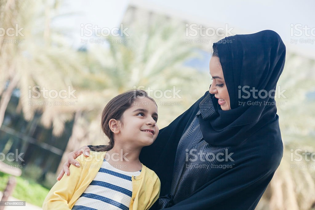 Arabic Mother And Daughter Outdoors stock photo