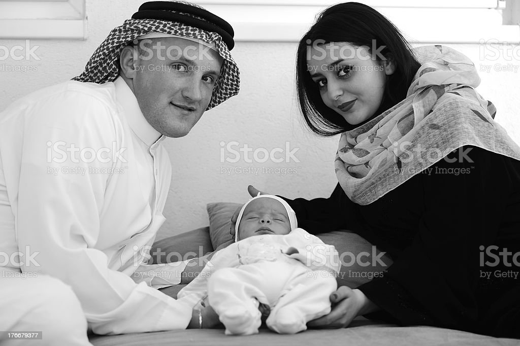 Arabic Muslim couple with new baby at home royalty-free stock photo