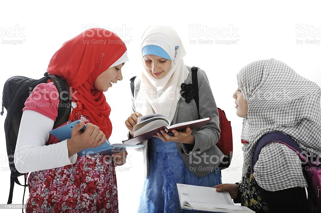 Arabic Muslim girls wearing Islamic clothes stock photo