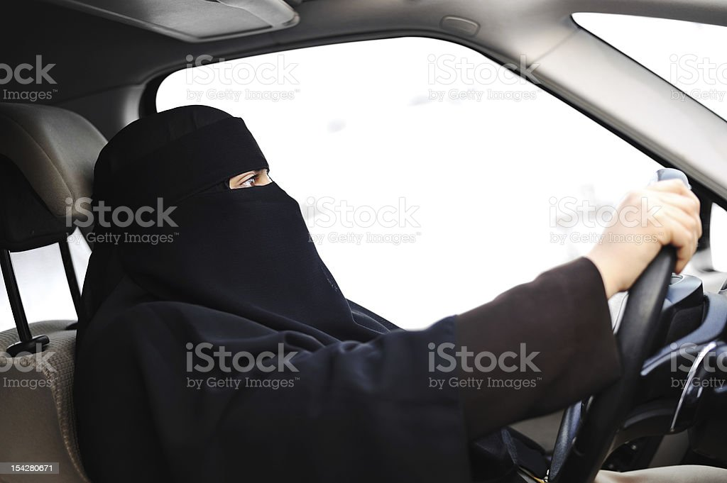 Arabic Muslim woman with veil and scarf  driving car stock photo