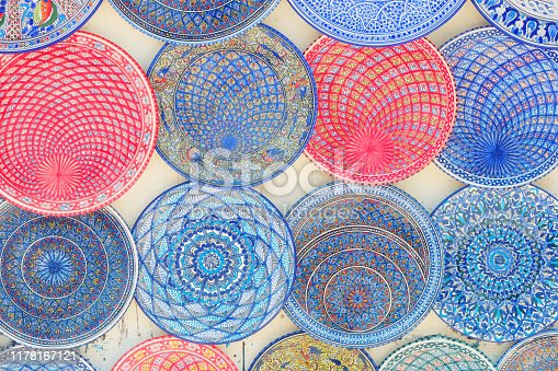 Arabic patterns on blue and red plates, background