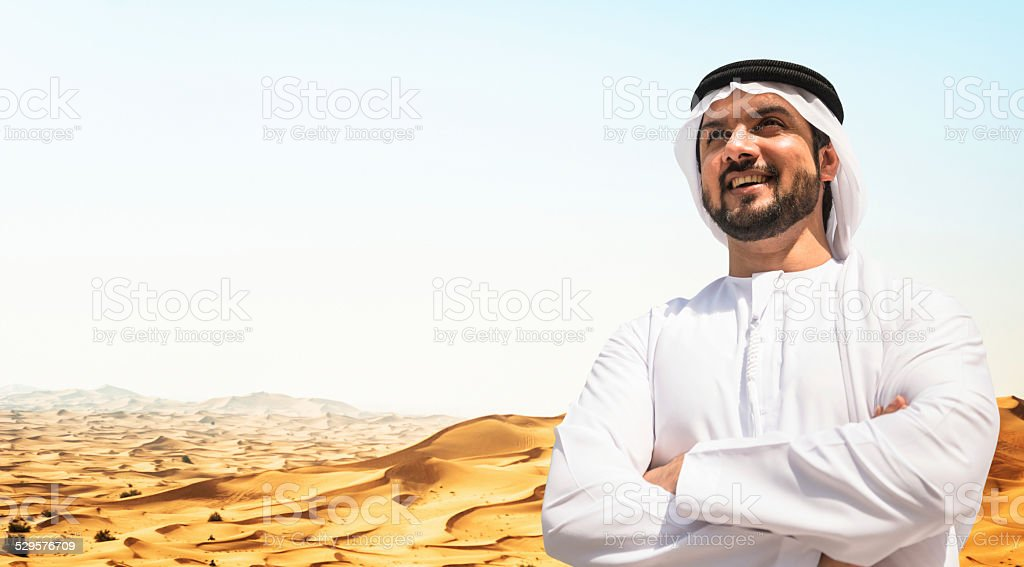 arabic sheik portrait on the desert stock photo