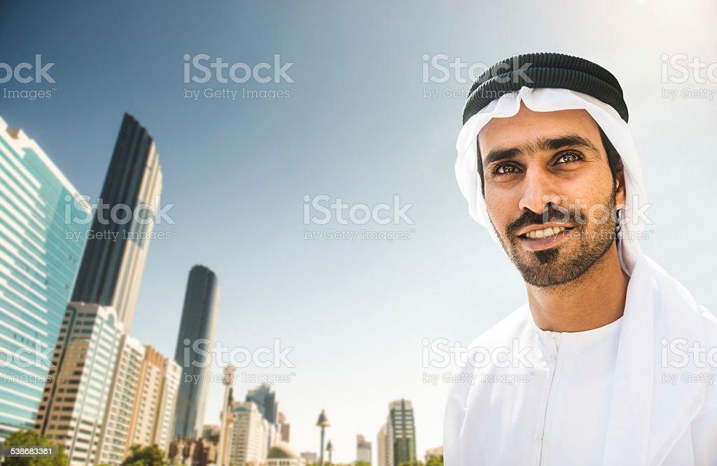 arabic sheik portrait with the Abu Dhabi Skyline stock photo