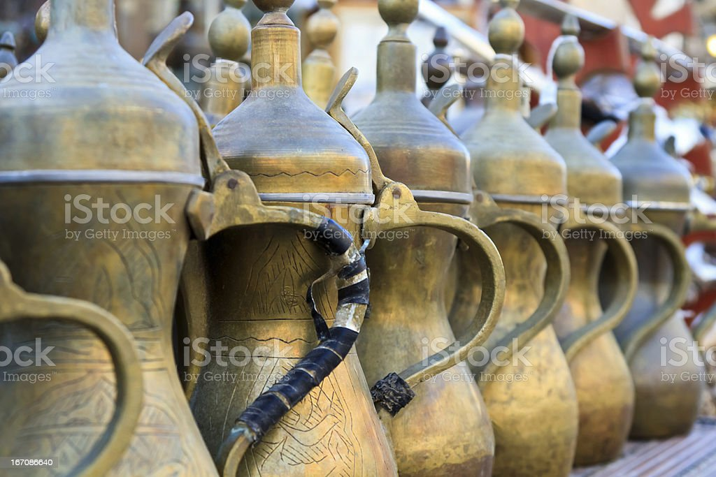 Arabic tea and coffee pots lined up stock photo