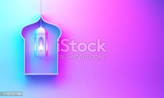 1130047135istockphoto Arabic window shelf and hanging lantern on blue pink violet gradient background. 1142727733