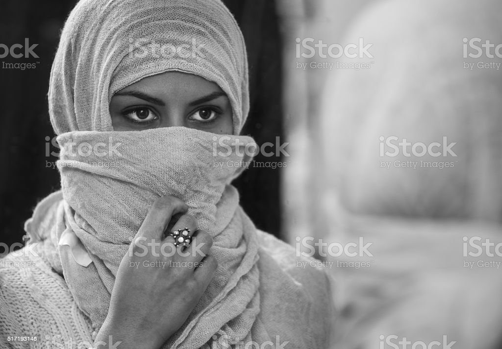 Arabic woman in the mirror. stock photo