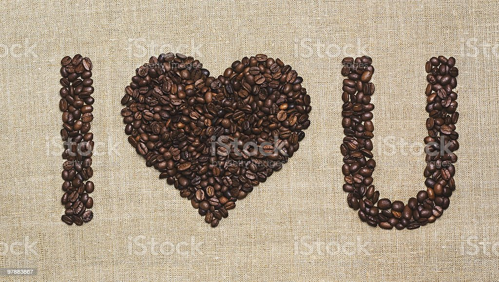 Arabica coffee beans on grunge canvas. I Heart You royalty-free stock photo