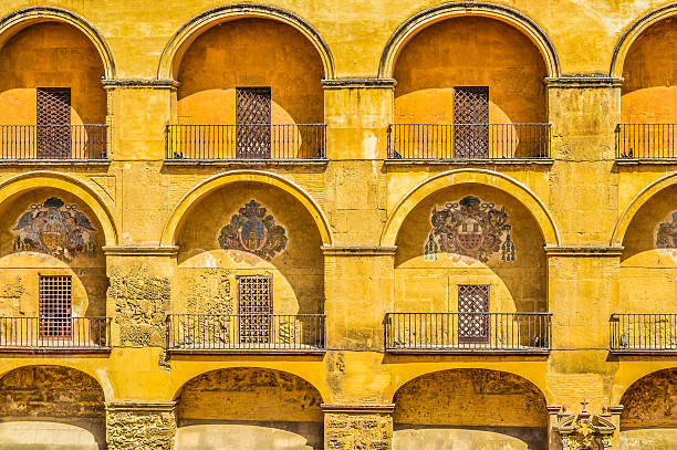 Arabic-style decor on old building Cordoba, Spain - August 10, 2015: Arabic-style decor on old building near the Roman Bridge in central Cordoba. Picture was taken during a wam summer day. palacios nazaries stock pictures, royalty-free photos & images