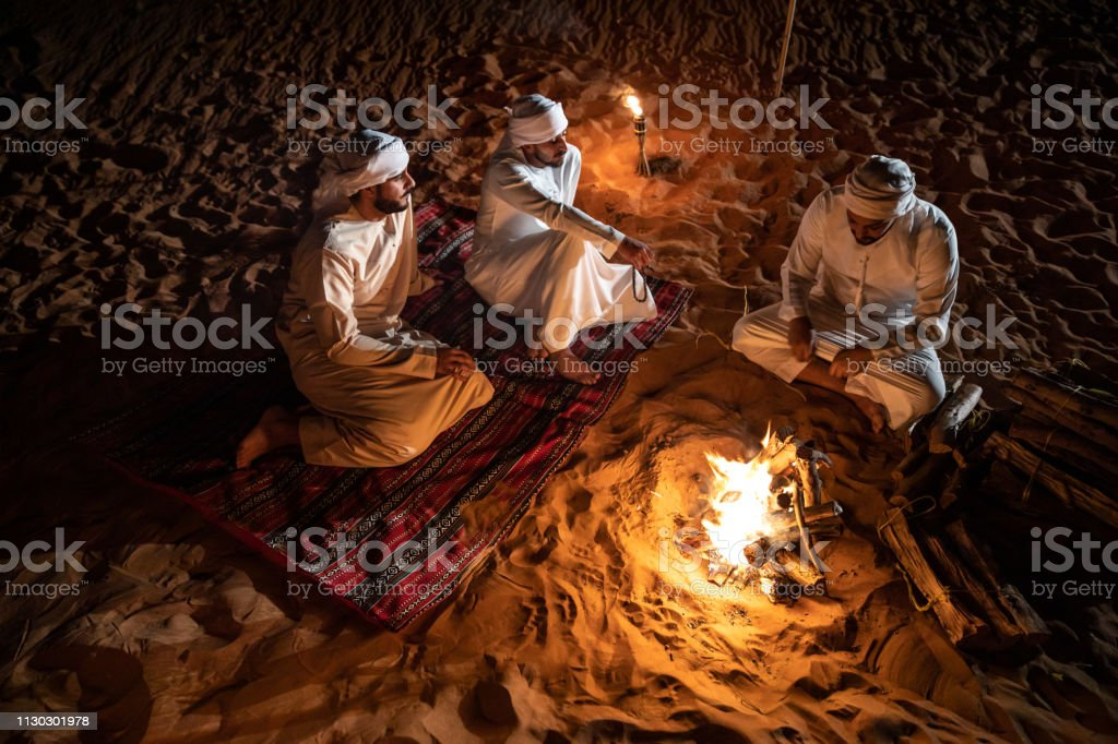 Arabs camping at night in the desert stock photo