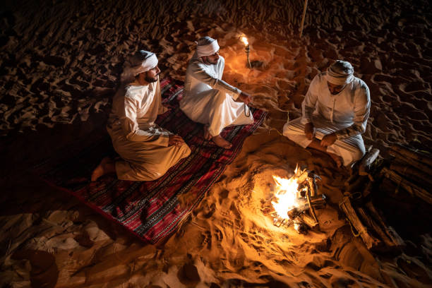 Arabs camping at night in the desert Arabs camping at night in the desert out of Dubai arabia stock pictures, royalty-free photos & images