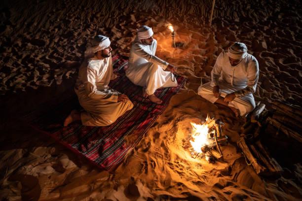 arabs camping at night in the desert - arab стоковые фото и изображения