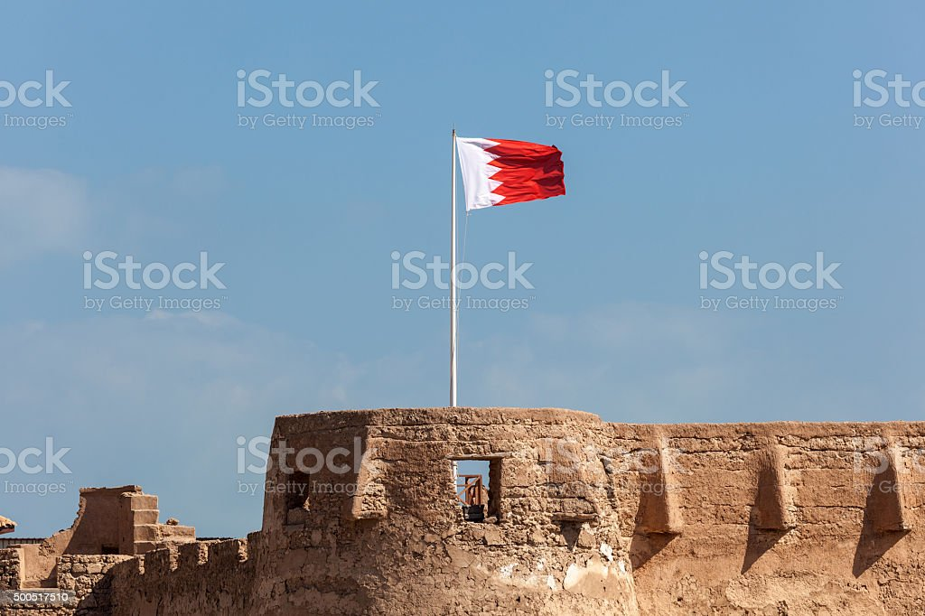 Arad fort with the national flag of Bahrain stock photo