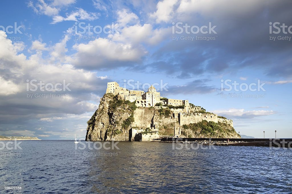 Aragonese castle in sunset light, Ischia island - Italy stock photo