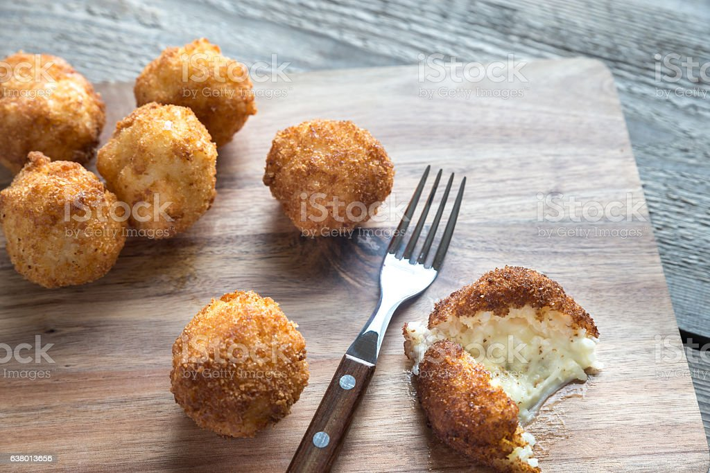 Arancini - rice balls with mozzarella stock photo