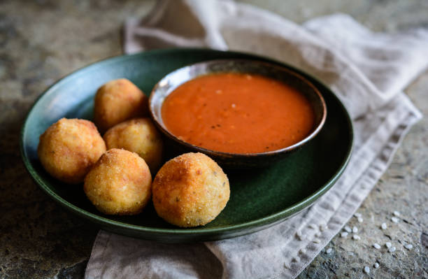 Arancini - traditional deep fried rice balls with meat and cheese stock photo