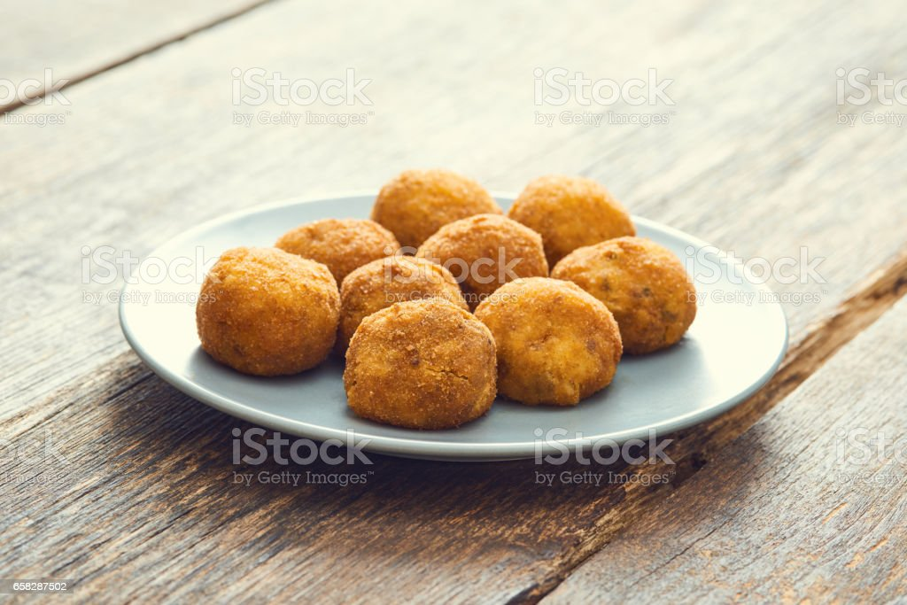 Arancini (deep fried rice balls with meat) Typical Sicilian street food stock photo