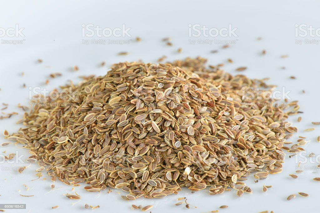 Arangement dill seed on white plate stock photo