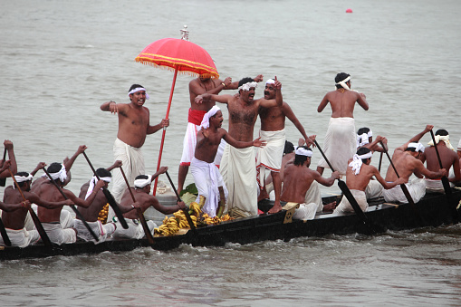 Aranmula,India-September 14, 2011:A team of oarsmen wearing traditional dress participate in the most popular Aranmula boat race