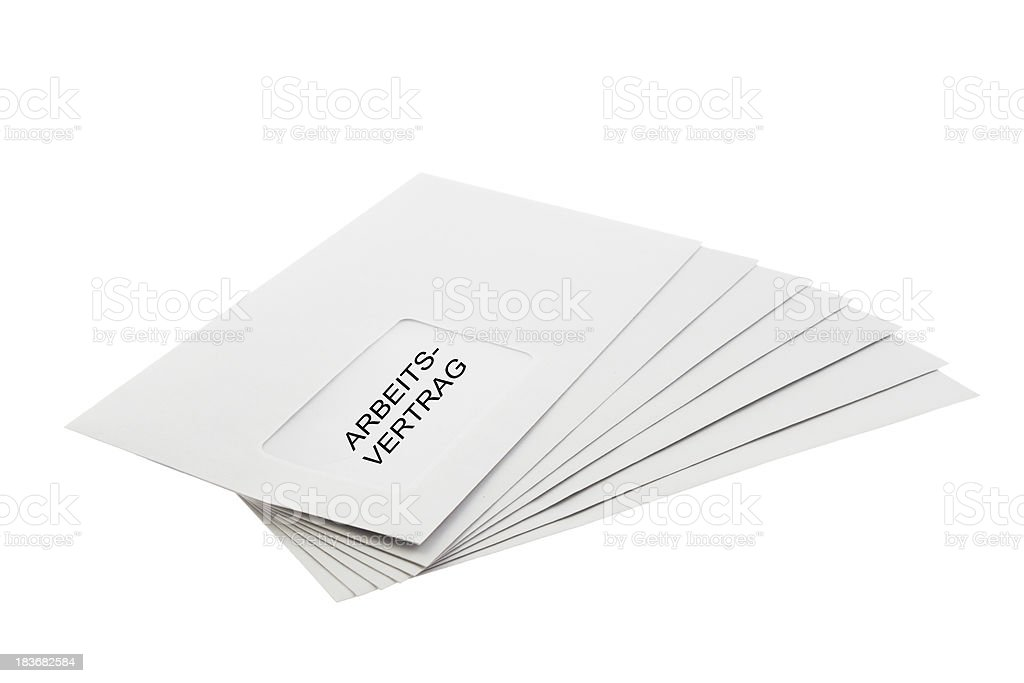 Arbeitsvertrag on a Batch of Envelopes isolated royalty-free stock photo