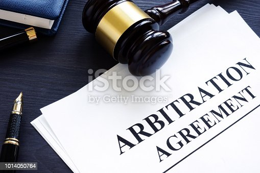 istock Arbitration agreement and gavel on a desk. 1014050764