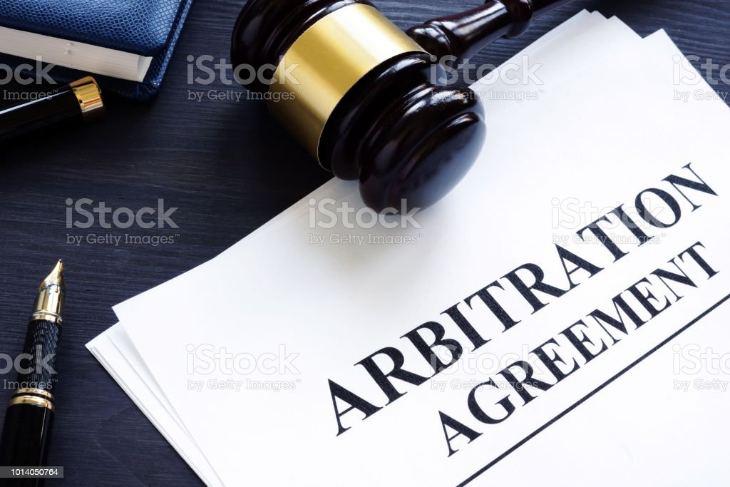 Arbitration agreement and gavel on a desk. stock photo