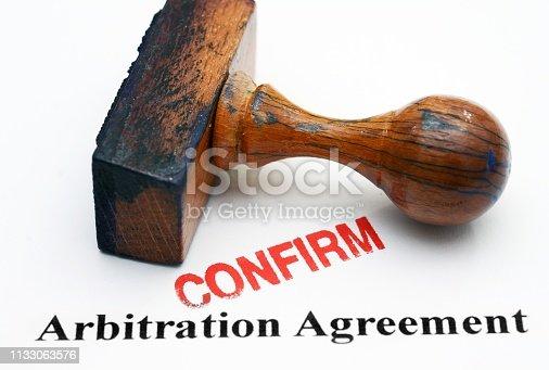 istock Arbitration agreement - confirm 1133063576
