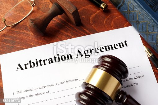 istock Arbitration agreement form on an office table. 665116770