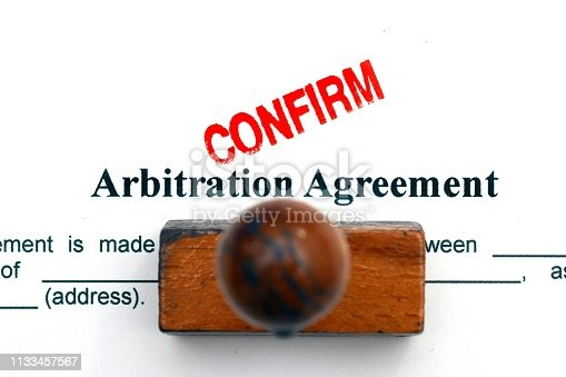 istock Arbitration agreement 1133457567