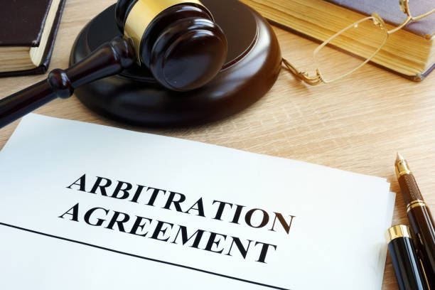 Arbitration agreement resolution of commercial disputes on a desk. stock photo