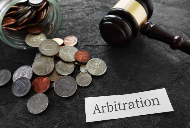 Arbitration news headline with coins and gavel stock photo
