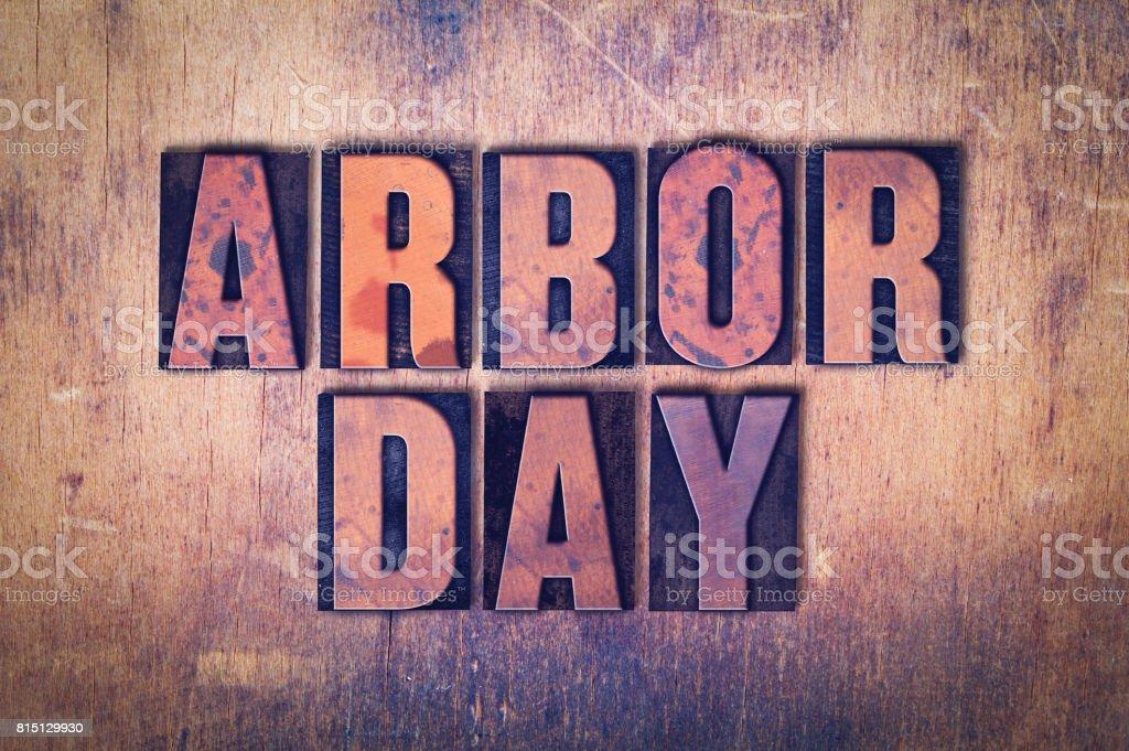 Arbor Day Theme Letterpress Word on Wood Background stock photo