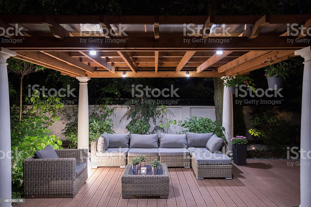Arbour with comfortable garden furniture stock photo