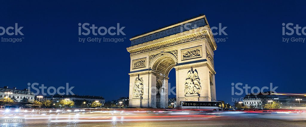 Arc de Triomphe and car lights stock photo
