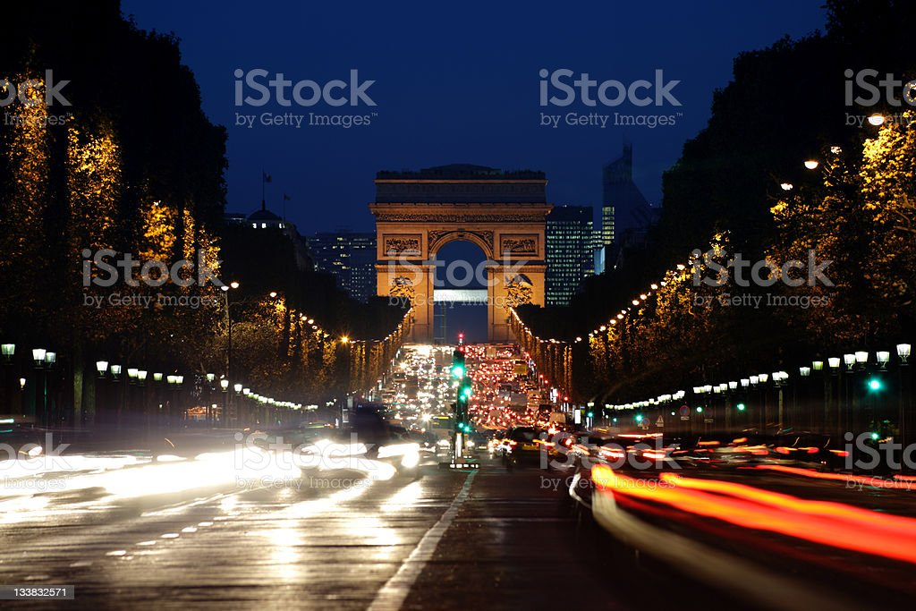 Arc de Triomphe and Champs-Elysees Avenue at night royalty-free stock photo