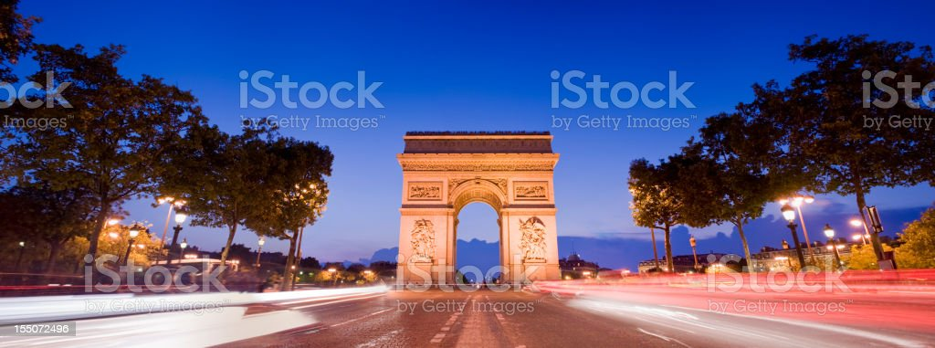 Arc de Triomphe at Night in Paris France stock photo