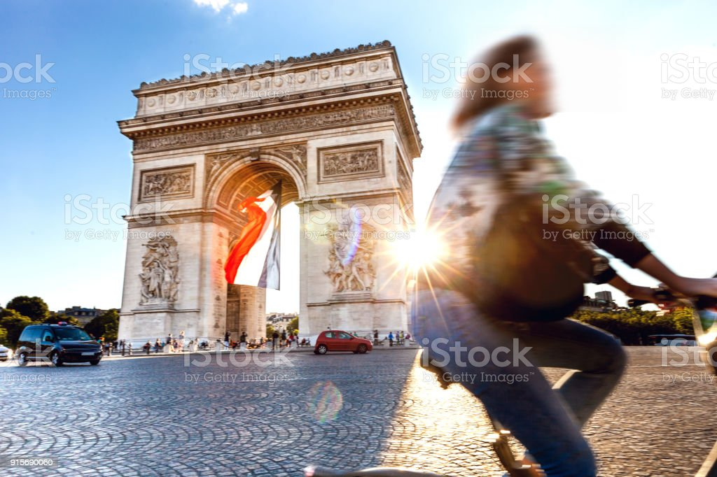Arc de Triomphe in Paris with a big French flag under it stock photo