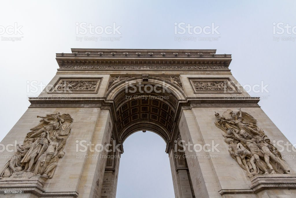 Arc de Triomphe (Triumph Arch, or Triumphal Arch) on place de l'Etoile in Paris, taken from below. It is one of the most famous monuments in Paris, standing at the end of Champs Elysees at the center of Place Charles de Gaulle stock photo