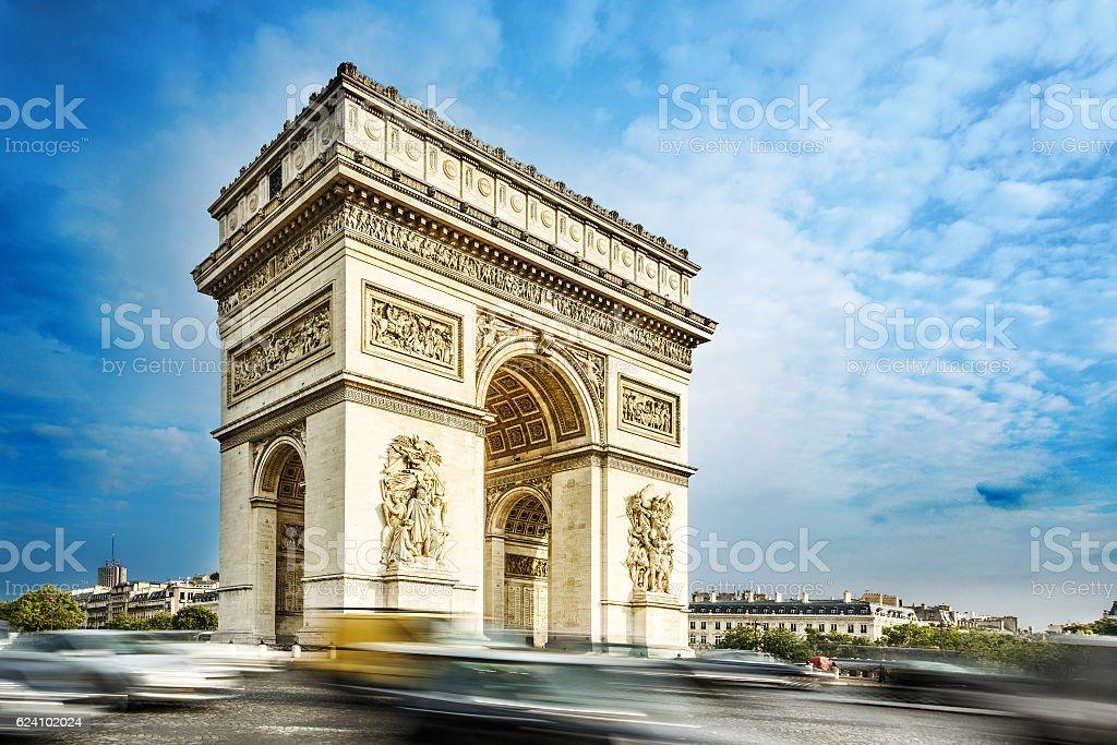 Arc de triomphe, Paris, France, at the blue sky background. stock photo