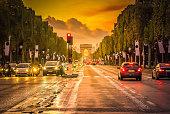 Arc de Triomphe and champ Elysees at sunset, Paris, France, retro toned