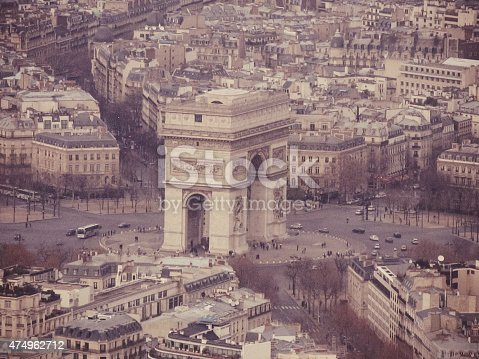 The Arc de Triomphe de l'Étoile, Arch of Triumph of the Star) is one of the most famous monuments in Paris. It stands in the centre of the Place Charles de Gaulle (originally named Place de l'Étoile), at the western end of the Champs-Élysées. It should not be confused with a smaller arch, the Arc de Triomphe du Carrousel, which stands west of the Louvre. The Arc de Triomphe honours those who fought and died for France in the French Revolutionary and the Napoleonic Wars, with the names of all French victories and generals inscribed on its inner and outer surfaces. Beneath its vault lies the Tomb of the Unknown Soldier from World War I.