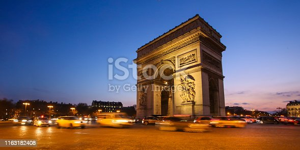 Arc de Triomphe on The Place Charles de Gaulle at night in Paris, France.