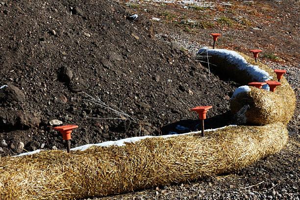 Arc of Fiber Rolls keeping black soil from eroding