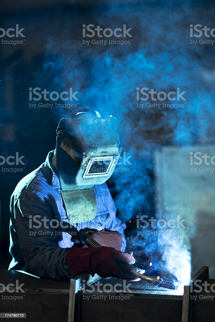 Arc welder with welding sparks royalty-free stock photo