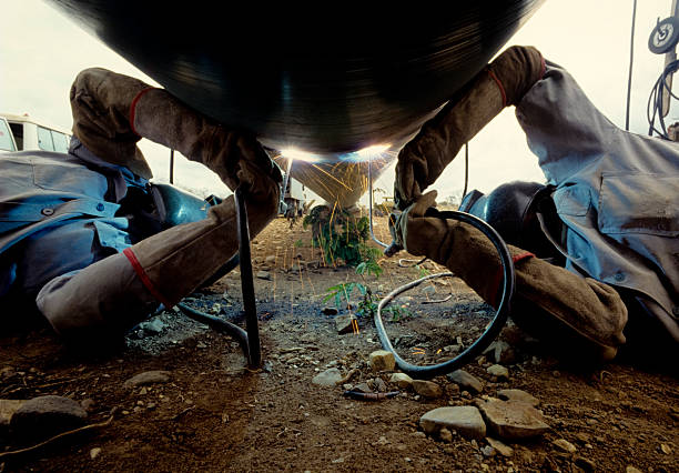 arc welders at work stock photo