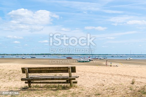Arcachon Bay, France - August 19, 2017: a bench on the beach of Claouey, near the Cap Ferret, one of the 23 oyster villages of the Arcachon Bay.